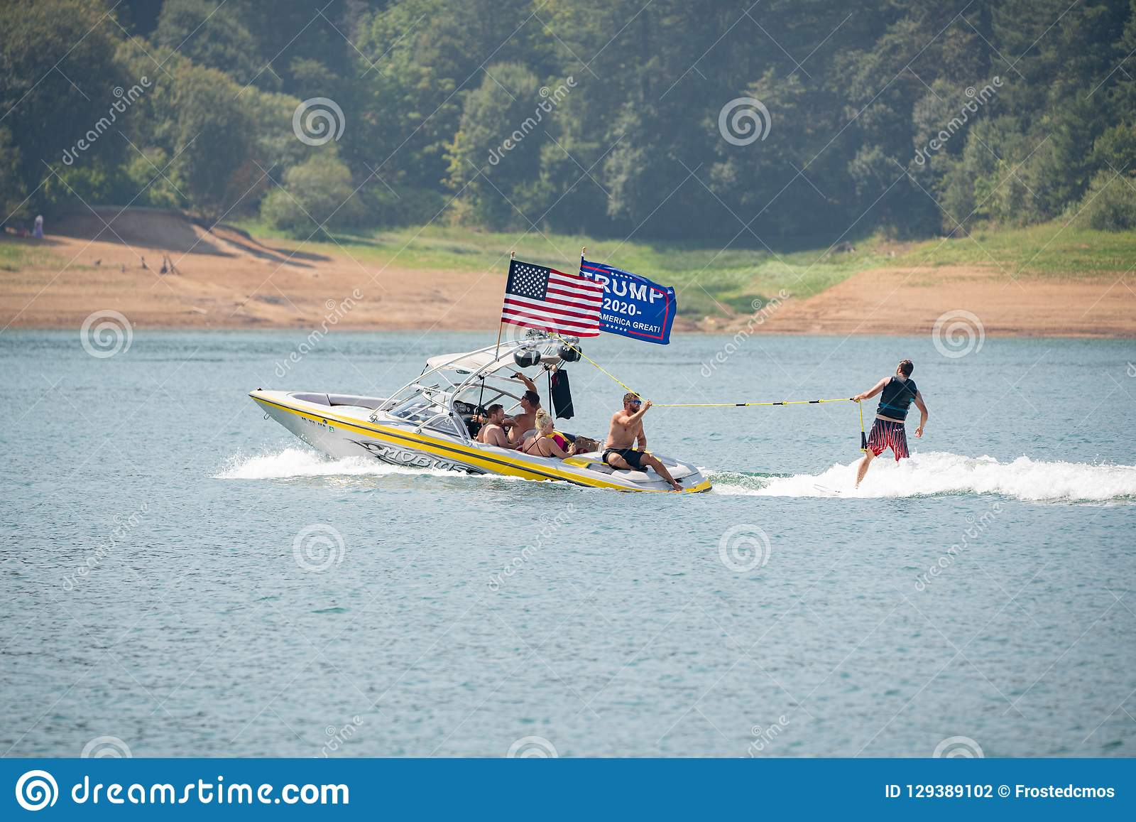 Motor boat with american and pro-trump flags on the lake
