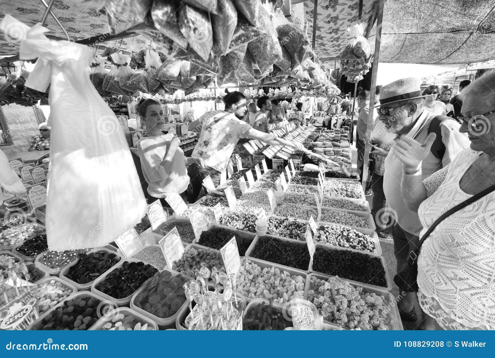 Haggling at the street market, Velez Malaga, Spain.