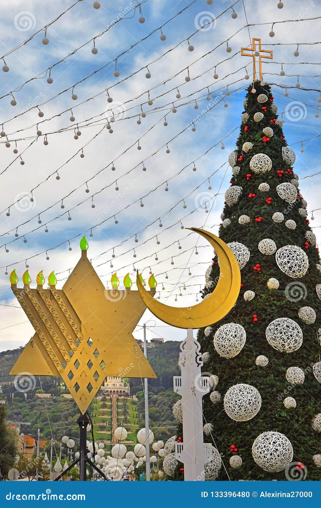 Islam Christmas.Christmas Tree Hanukkah Menorah And Crescent In Haifa