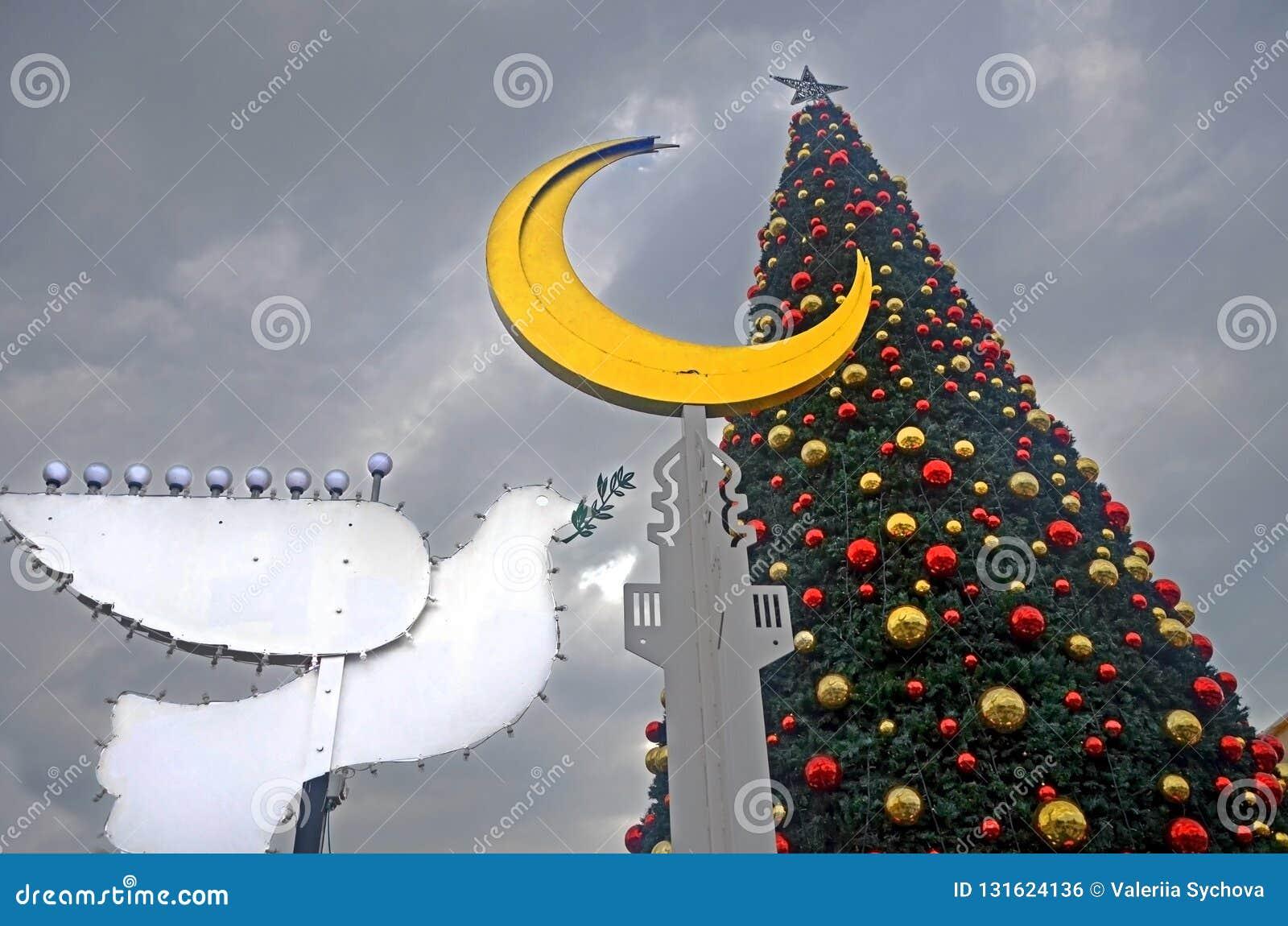 HAIFA, ISRAEL - DECEMBER 30, 2017: Holiday decorations street for holidays, Christmas tree and Hanukkah menorah in the form of a