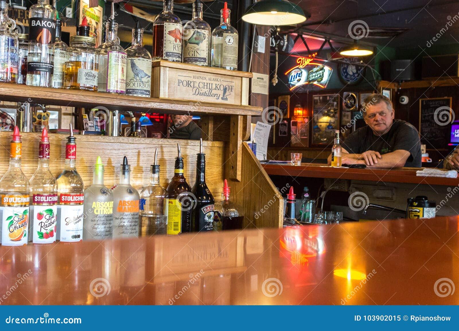 Alaskan man having a beer in Haines.