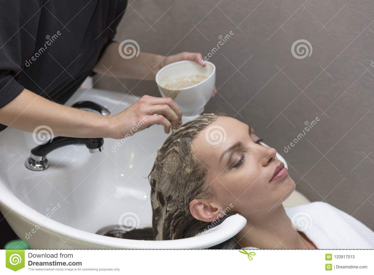 Hair beauty care, moisturizer application, hairdresser, hair mask of a beautiful girl, natural, health and beauty