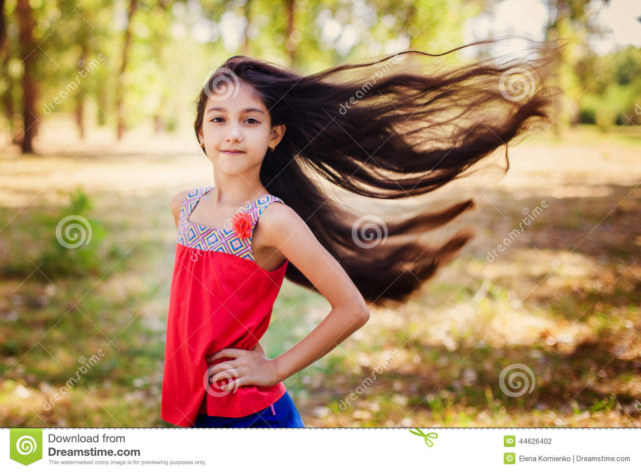 Girl with hair blowing in the wind