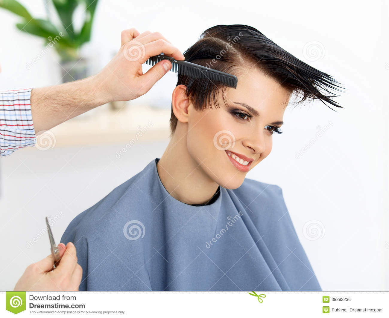 Hair. Hairdresser doing Hairstyle. Beauty Model Woman. Haircut