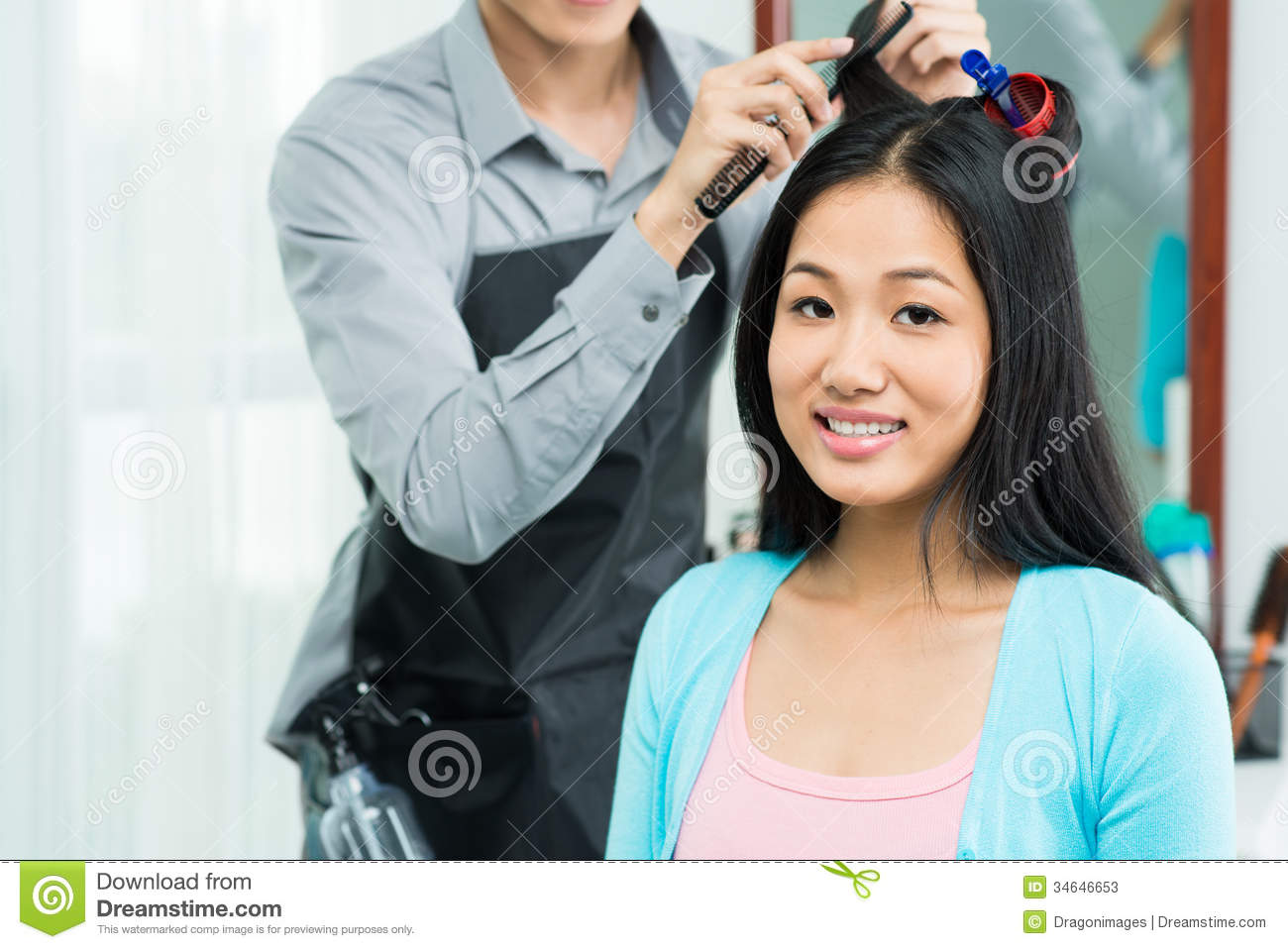 ... of a young women having hair procedure in salon on the foreground