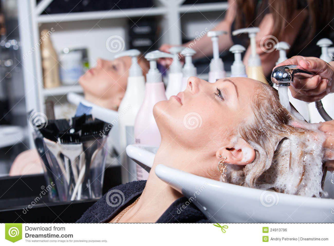 Hair washing at a hairdressing salon royalty free stock for Salon younga