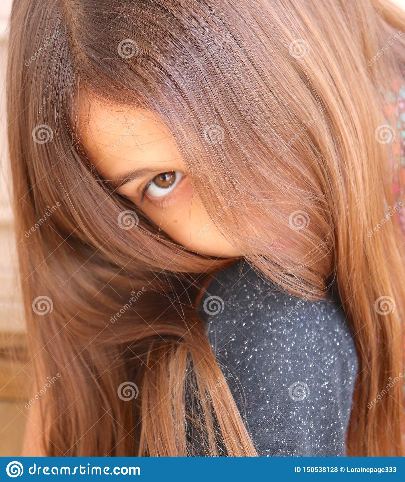 Hair on Young Girl Brushed Softly