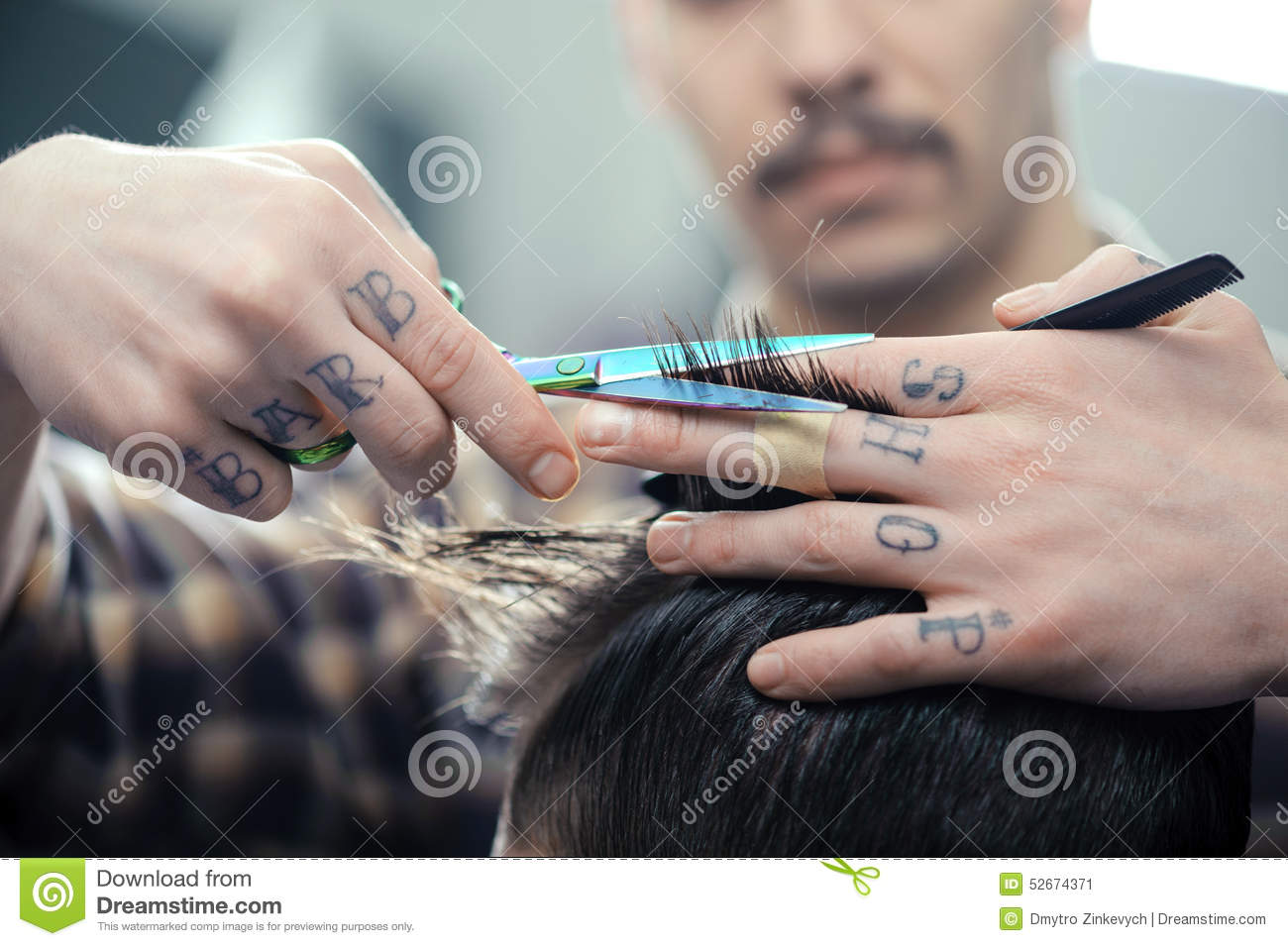 50cefd27e Closeup of barbers tattooed hands combing hair making haircut to a male  client