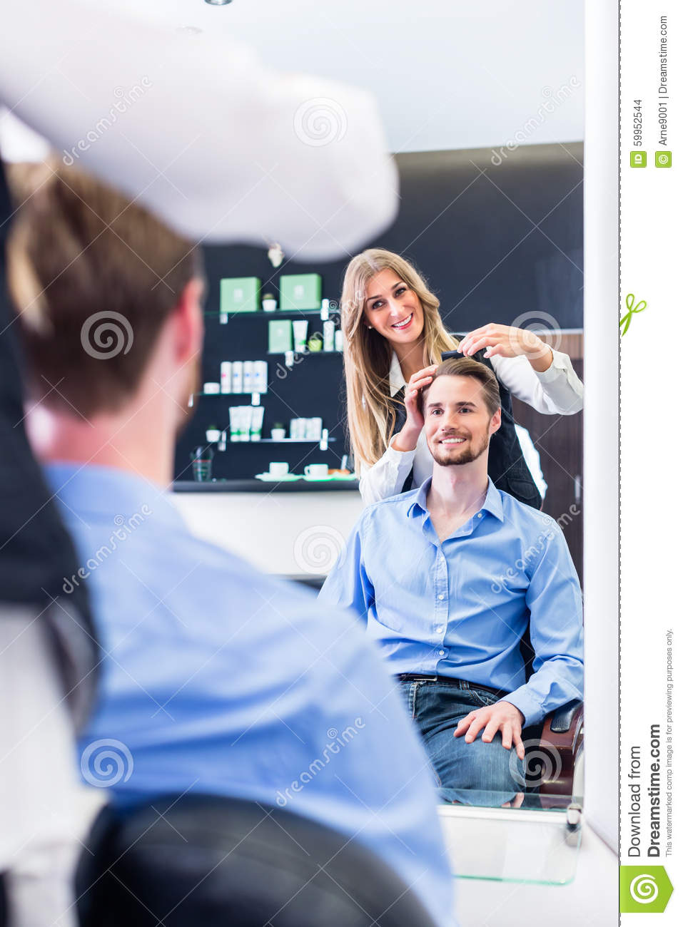 Haircutter Cutting Hair, Shot In Mirror Stock Photo - Image: 59952544