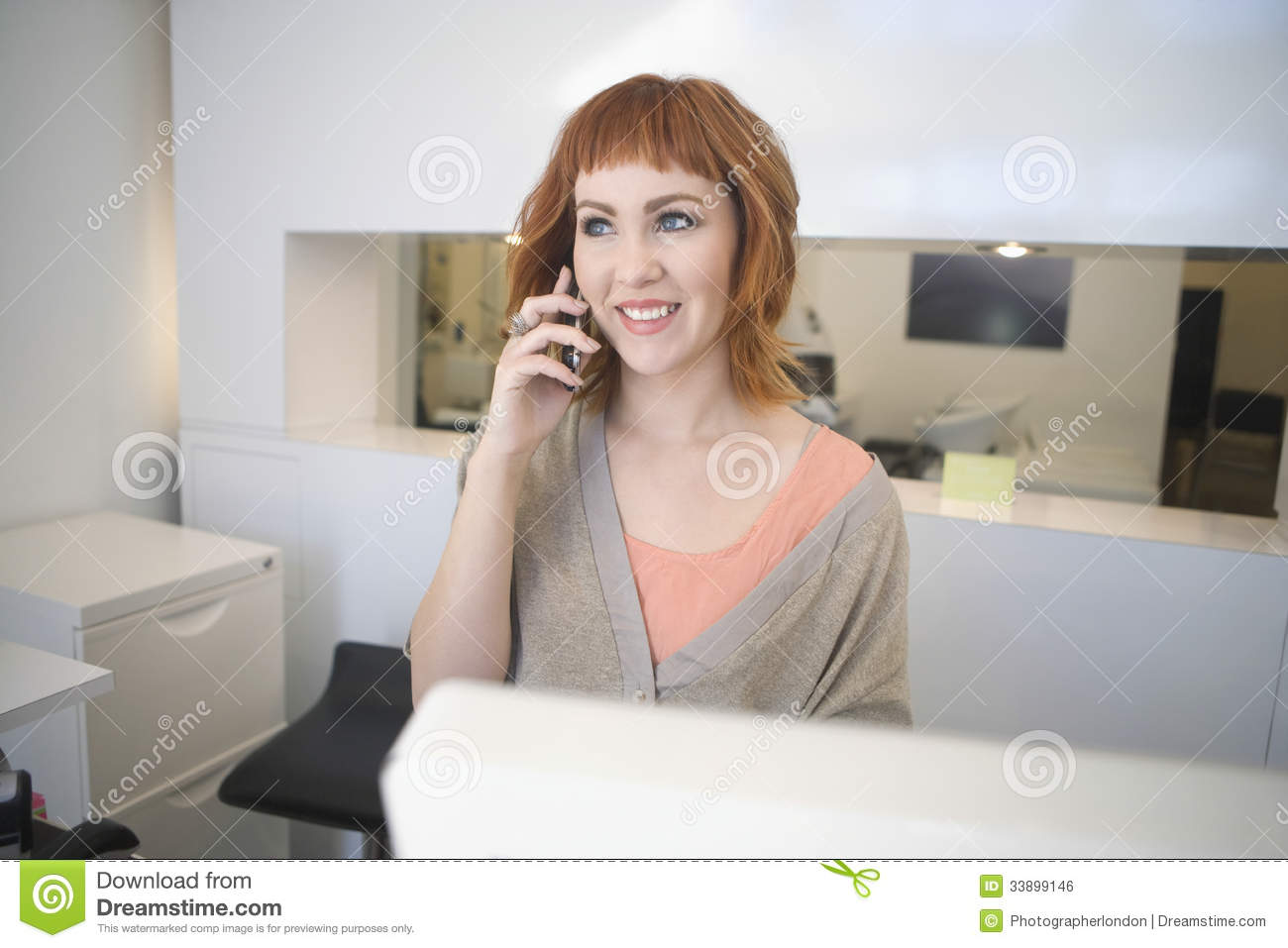 young female receptionist beauty salon stock photos images hairdresser answering mobilephone at reception in salon royalty stock image