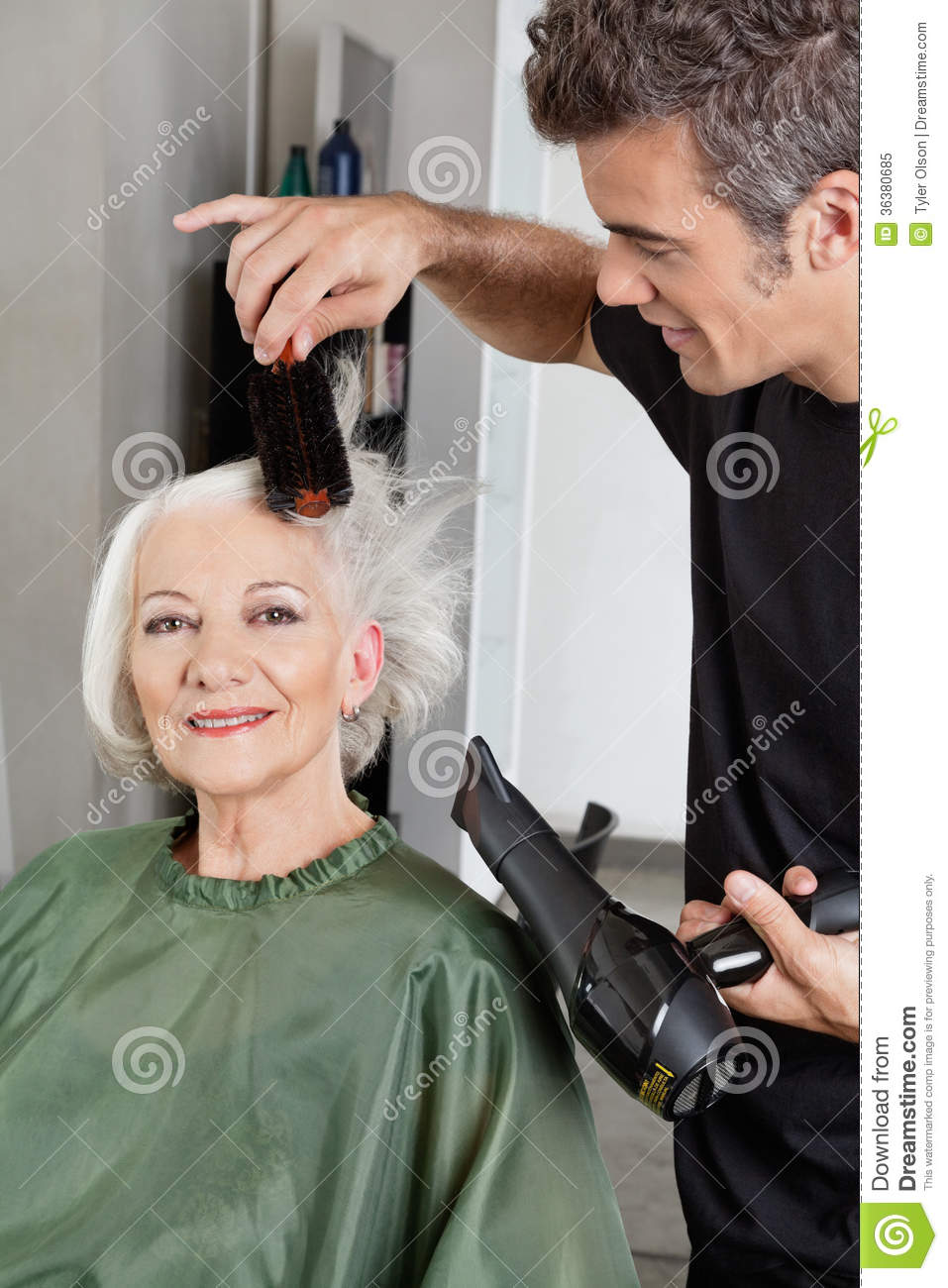 hairdresser blow drying woman u0026 39 s hair royalty free stock