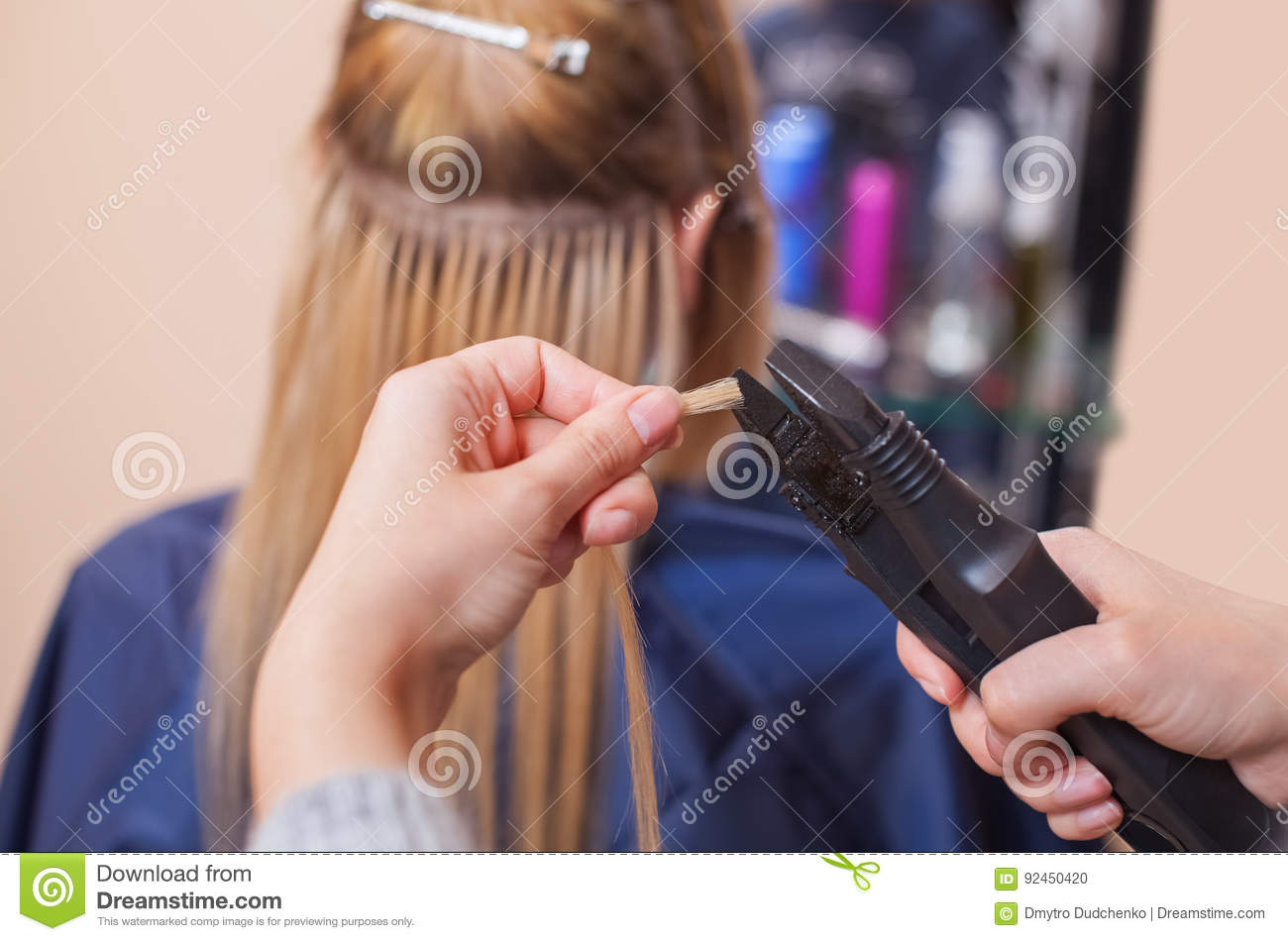 The Hairdresser Does Hair Extensions To A Young Girl A Blonde In A