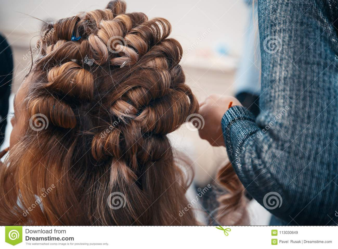 The Hairdresser Does Hair Extensions To A Young Girl Stock Image