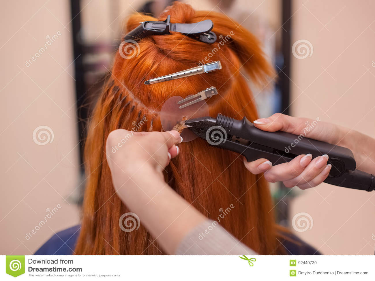 The Hairdresser Does Hair Extensions To A Young Red Haired Girl