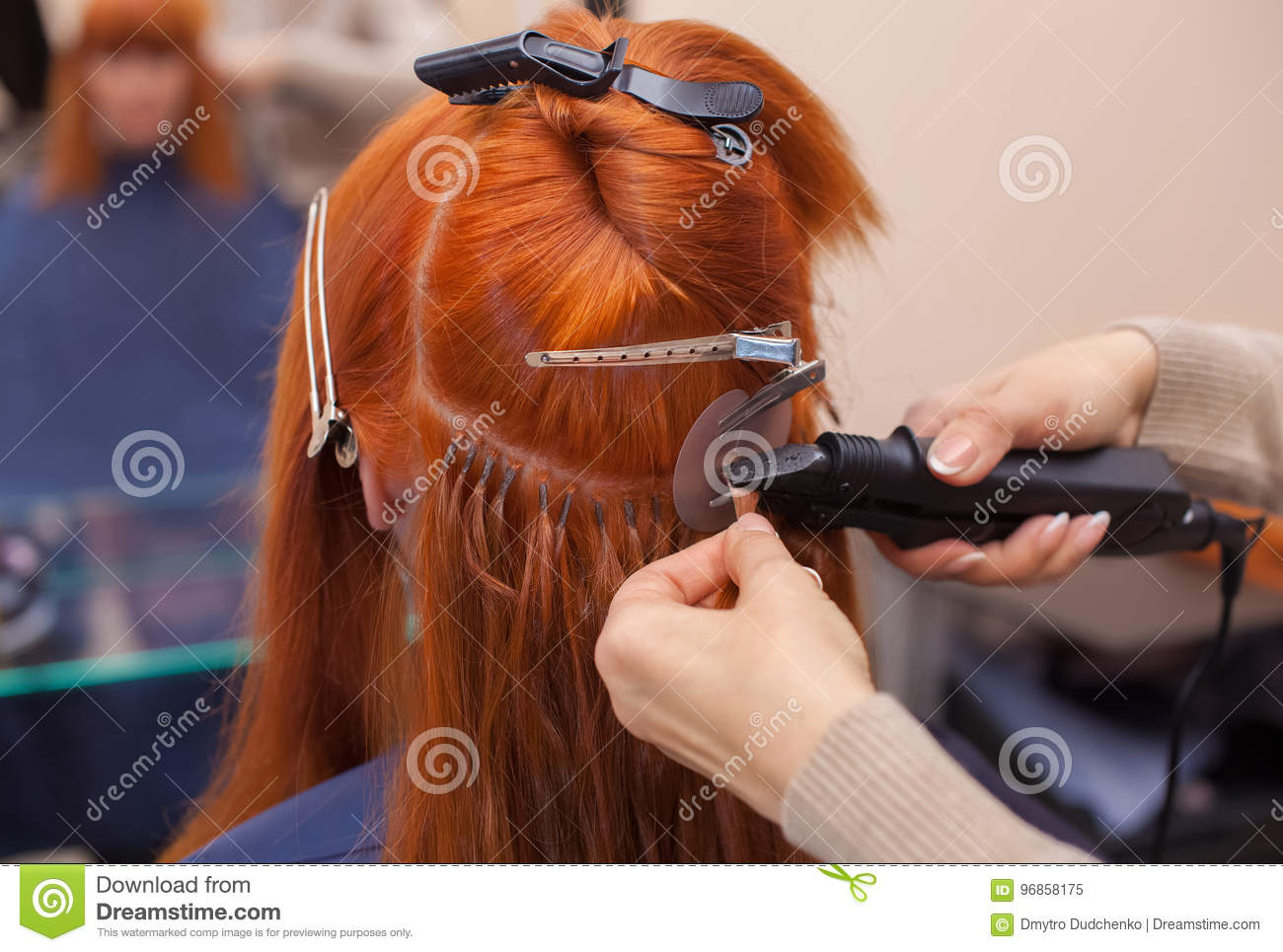 The Hairdresser Does Hair Extensions To A Young Red Haired Girl In