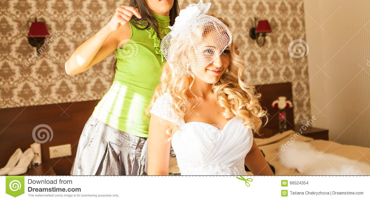 The Hairdresser Does A Hairstyle To The Bride Stock Photo Image Of