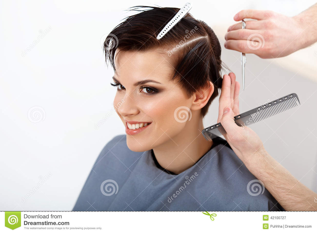 Hairdresser doing Hairstyle. Brunette with Short Hair in Hair Sa