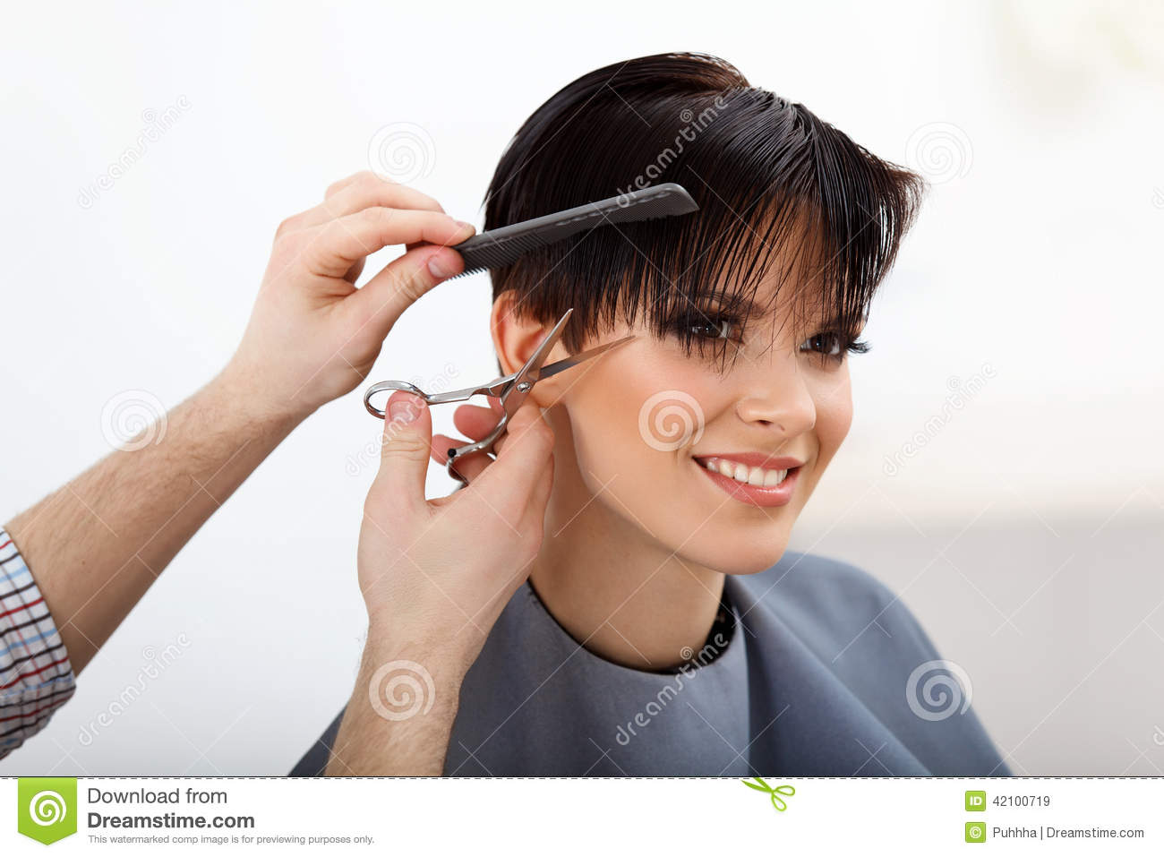 Hairdresser doing Hairstyle. Brunette with Short Hair in Salon