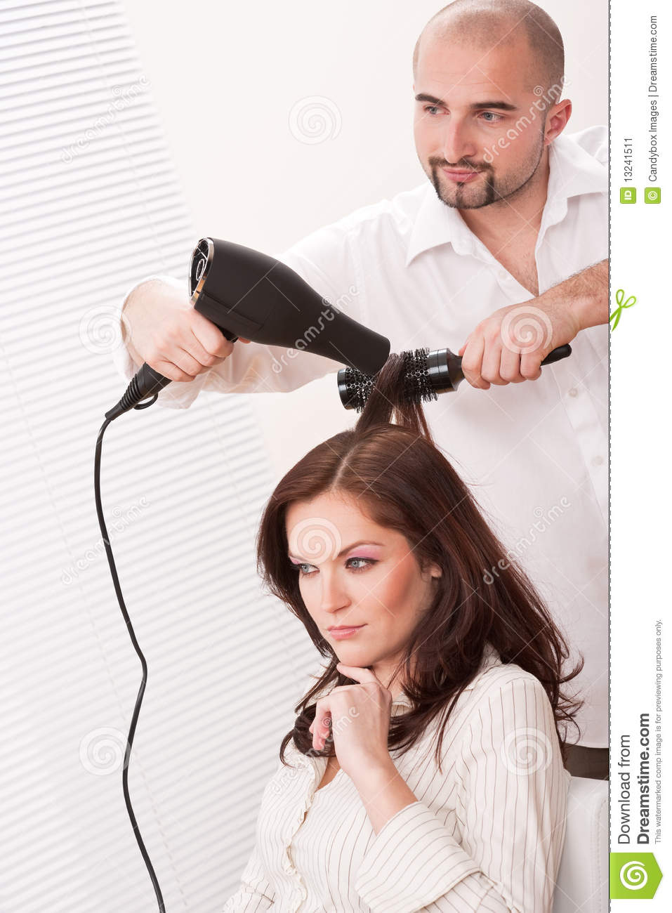 Hairdresser With Hair Dryer At Salon With Customer Stock ...