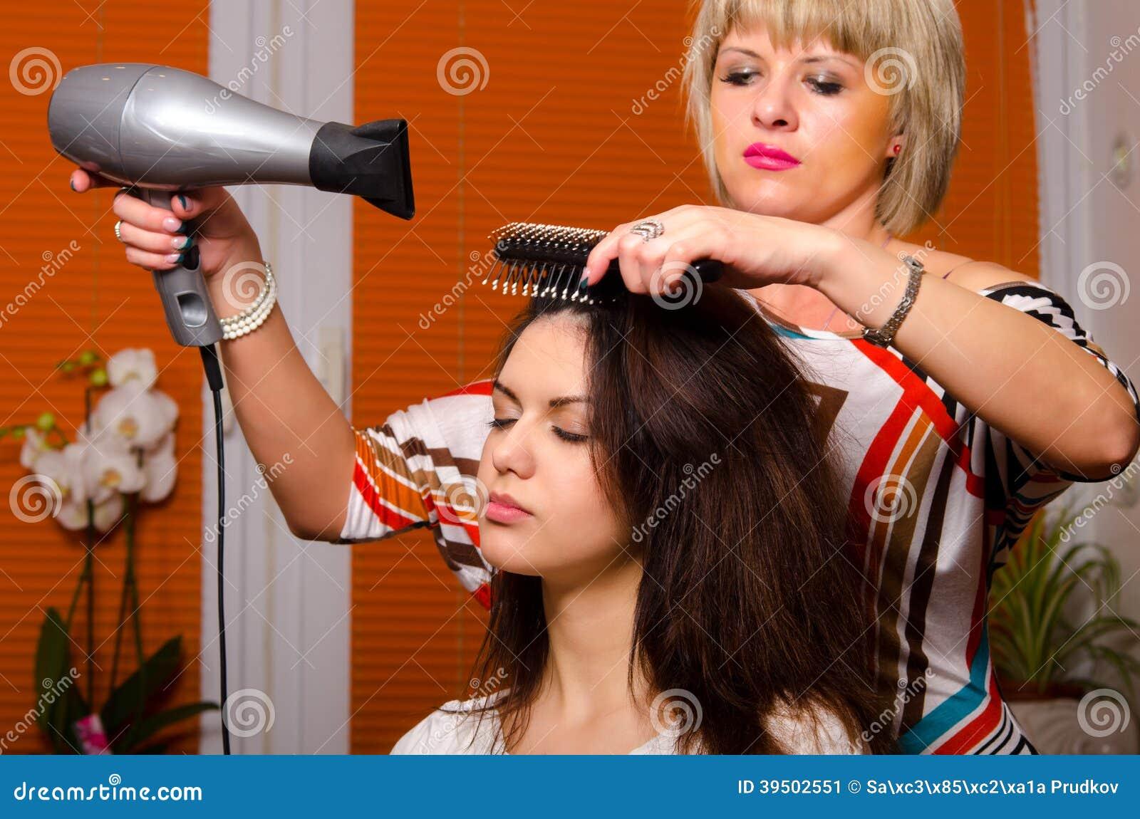 Hairdresser making hair