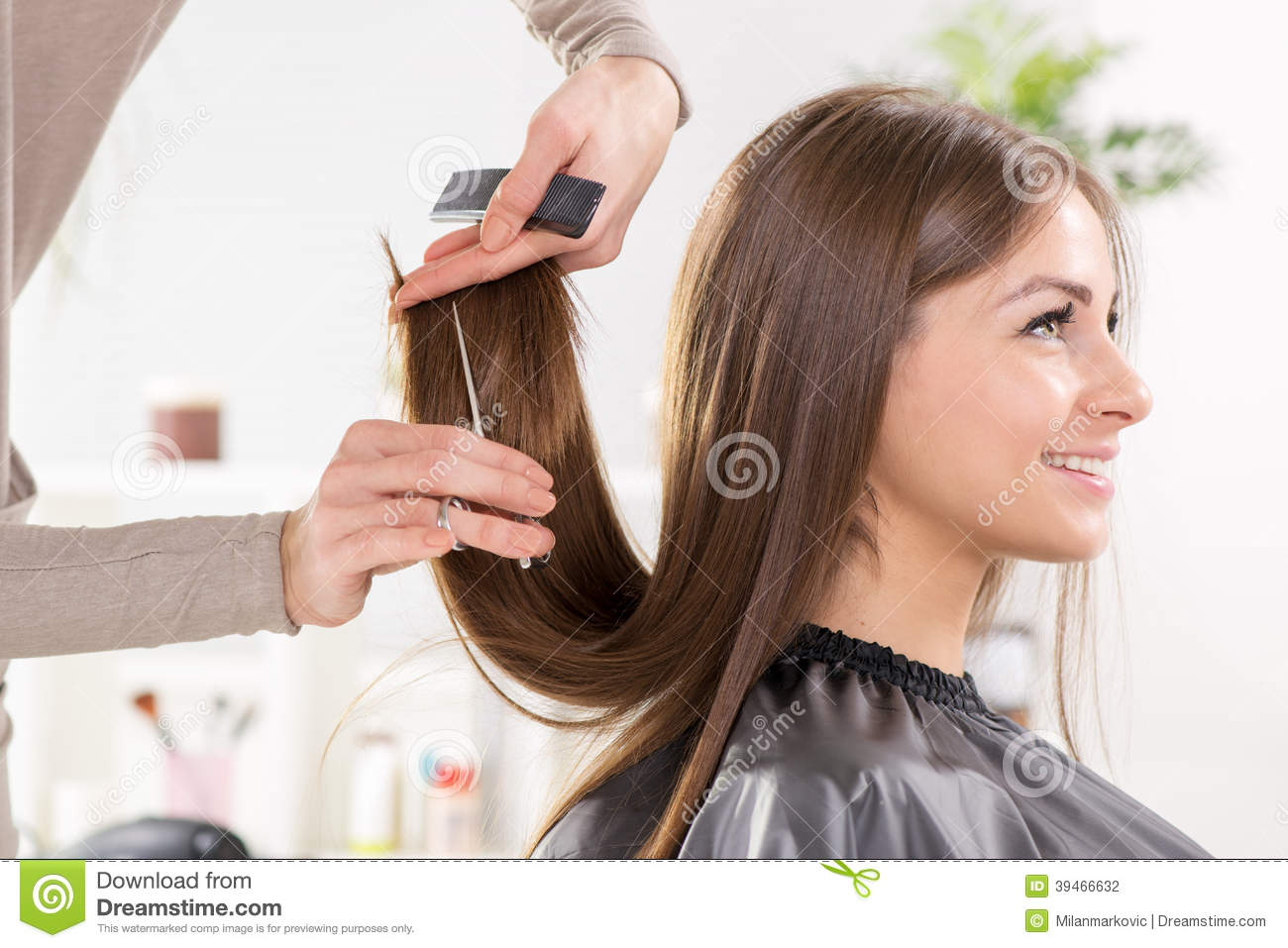 Beautiful Hair Cutting : Young beautiful woman having her hair cut at the hairdressers.