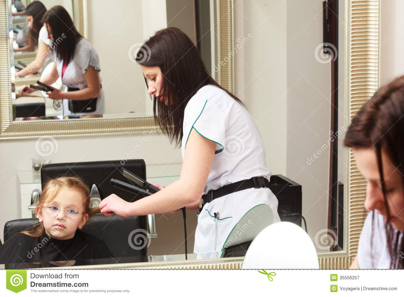 Hairdresser straightening hair little girl child in for A little off the top salon