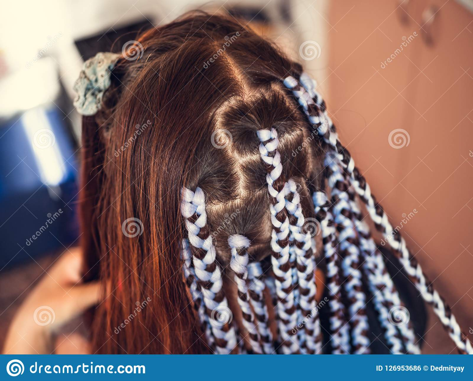 Awe Inspiring Hairdresser Weaves Braids With Kanekalon Material To Young Girl Schematic Wiring Diagrams Amerangerunnerswayorg