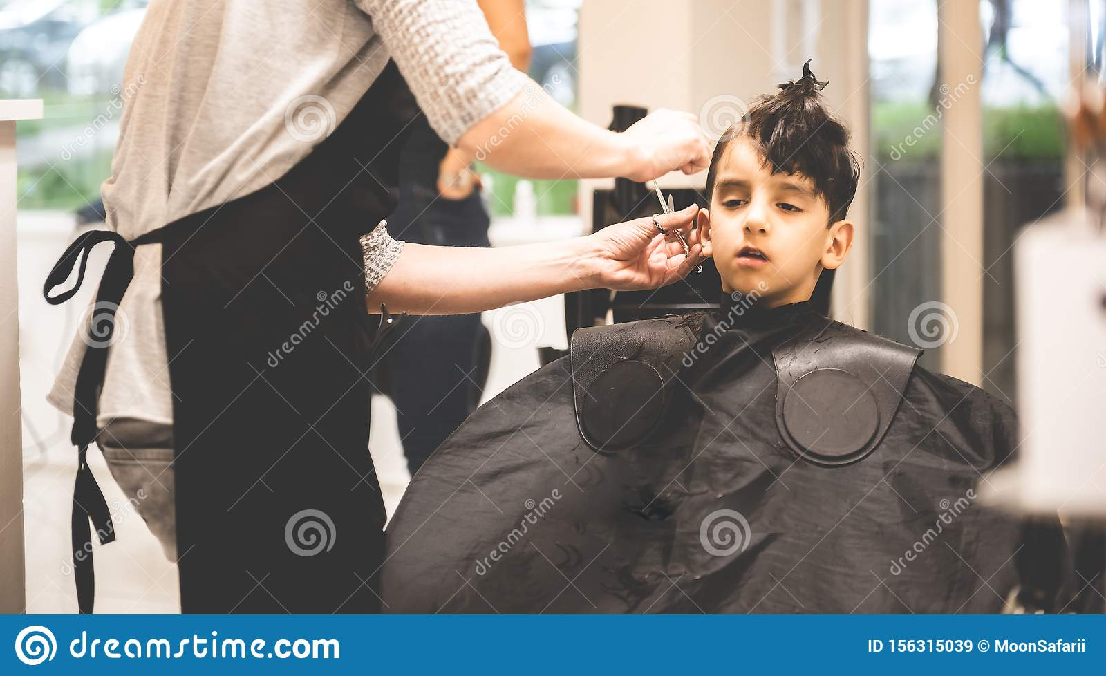 Hairdressers Hands Making Hairstyle To Child Little Boy In The Barber Shop Hair Cut Professional Little Boy In The Barber Shop Stock Image Image Of Childhood Client 156315039