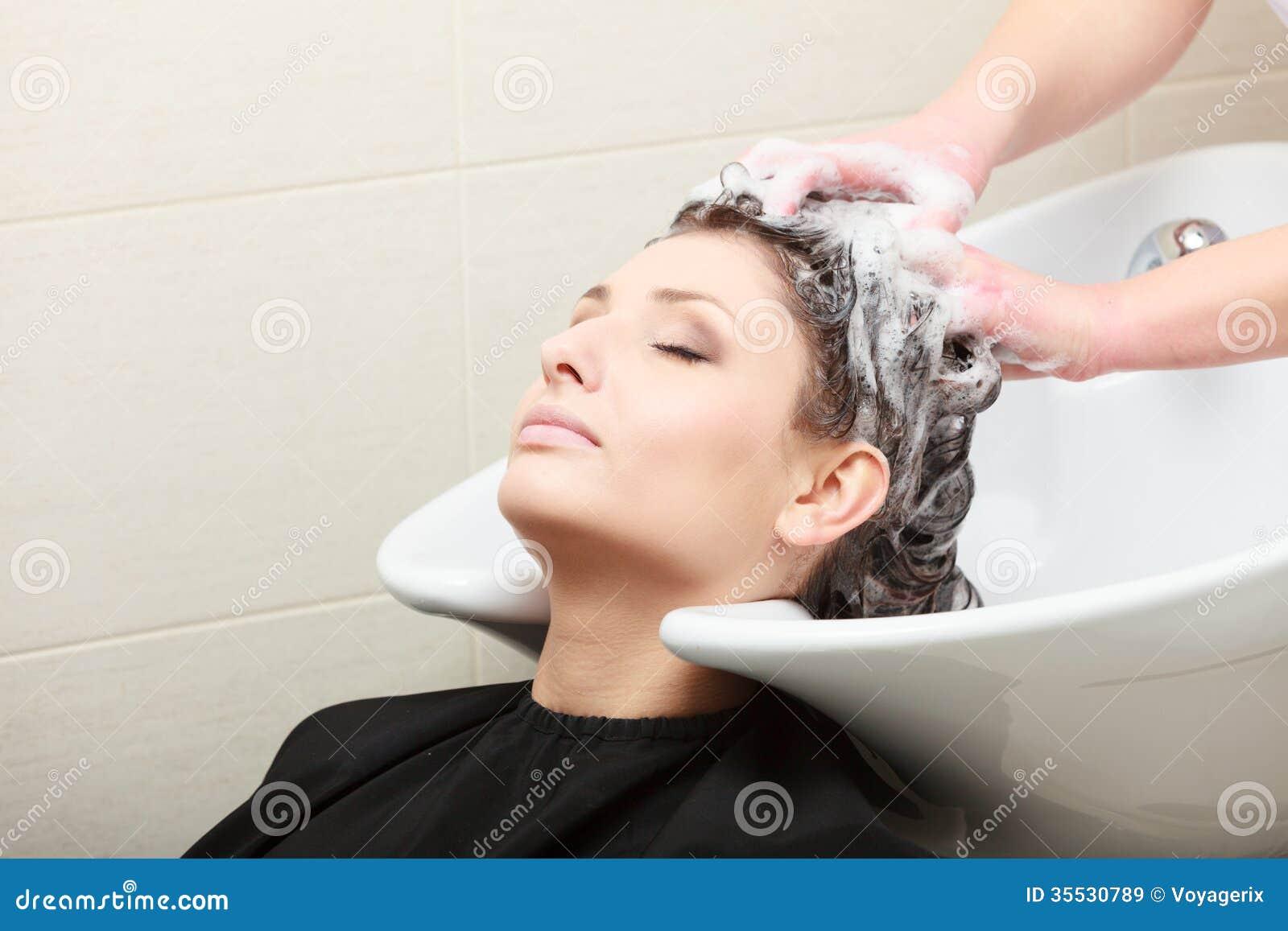 Hair washing at a hairdressing salon royalty free stock for Wash hair salon