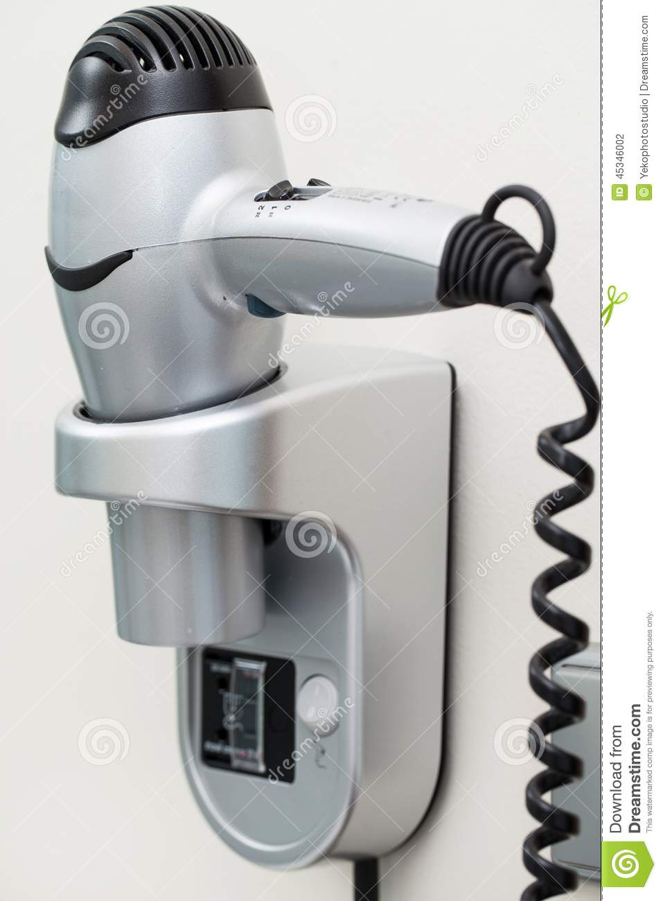 hairdryer with cord attached to a wall stock photo image 45346002. Black Bedroom Furniture Sets. Home Design Ideas