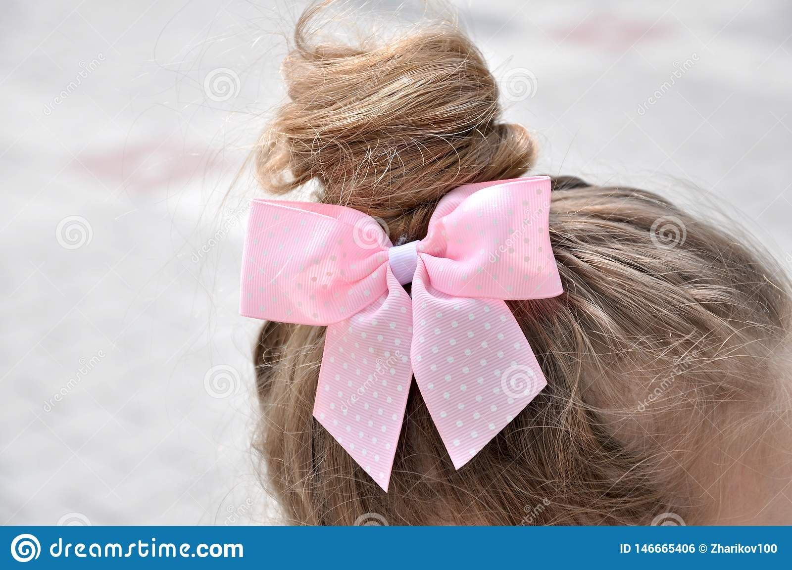 Hairstyle with a girl bow