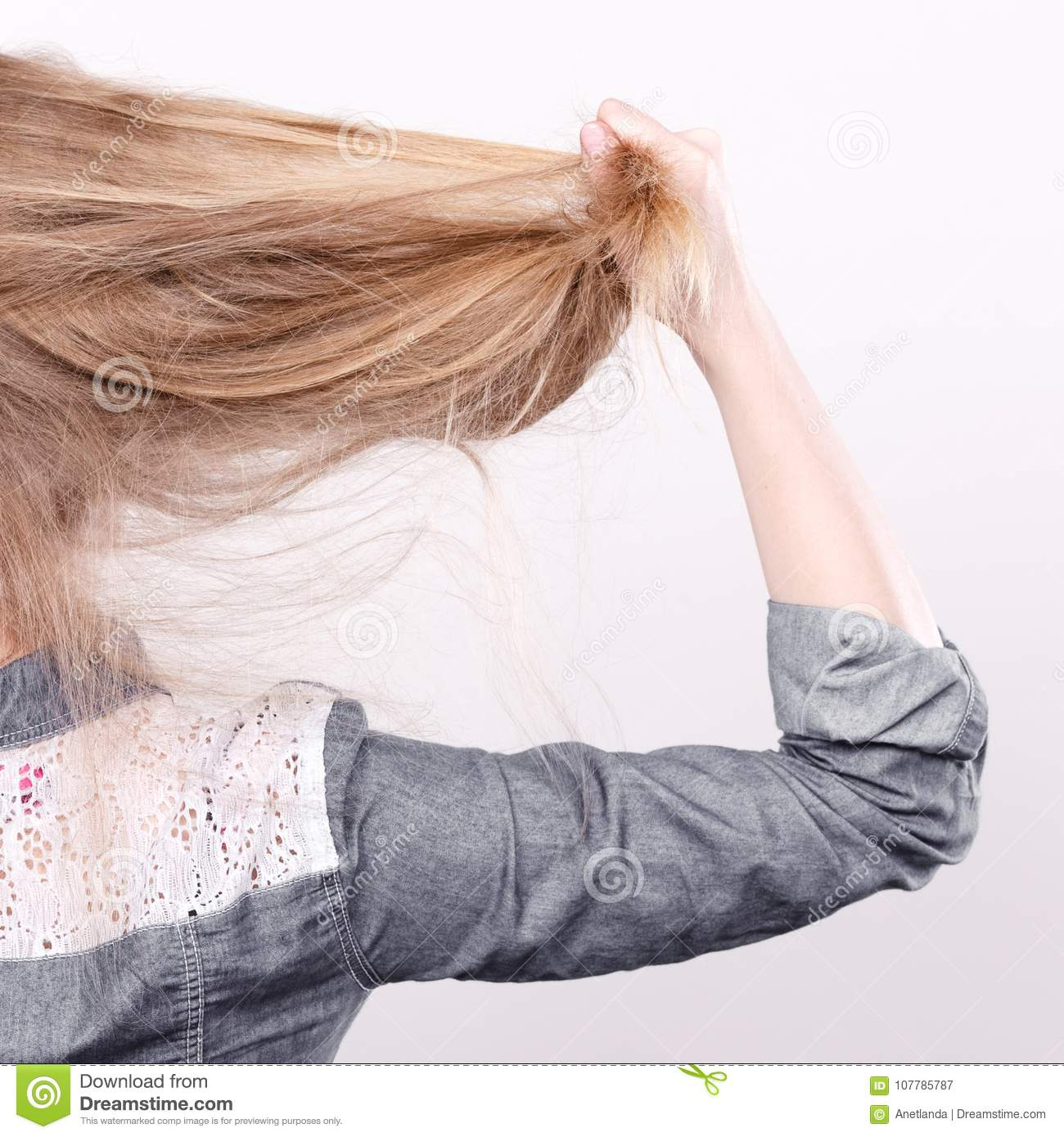 Blonde Woman Playing With Hair Stock Image Image Of Styling