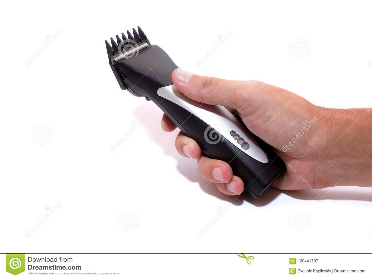A Hairstyle Machine Barbershop Hair Clipper In Hand Isolated On