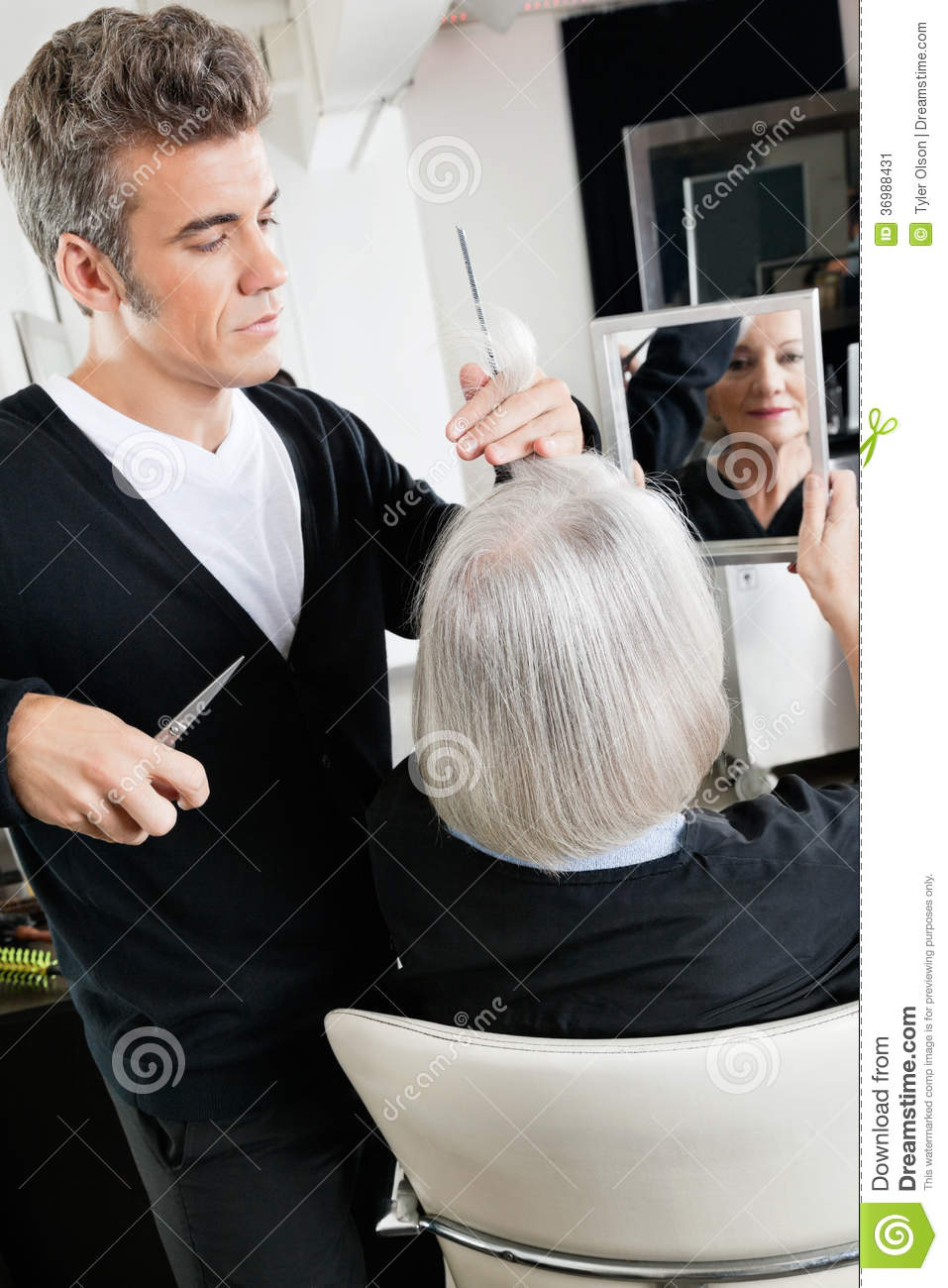 Hairstylist Cutting Hair At Salon Stock Image - Image ...