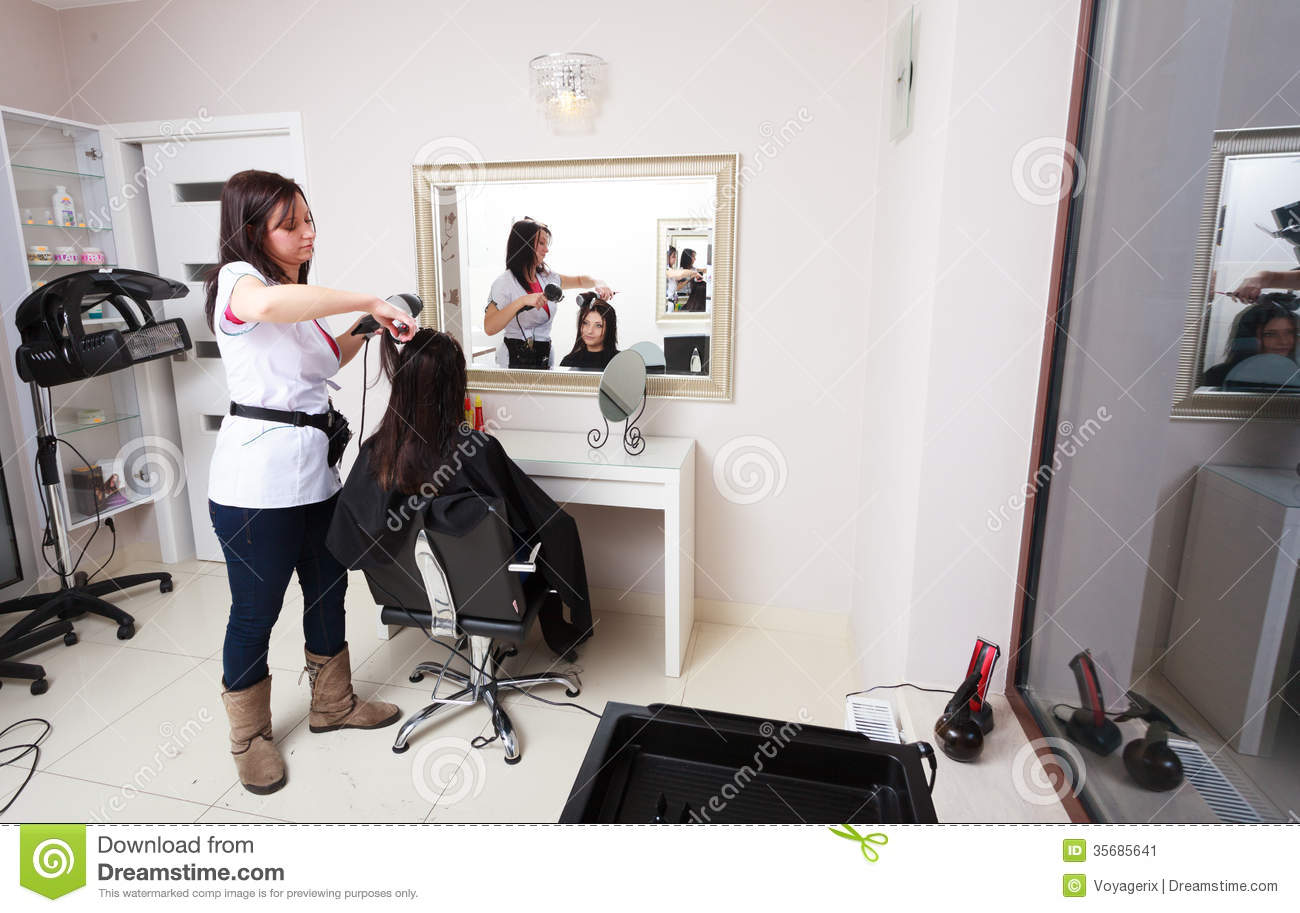 Hairstylist Drying Hair Woman Client In Hairdressing