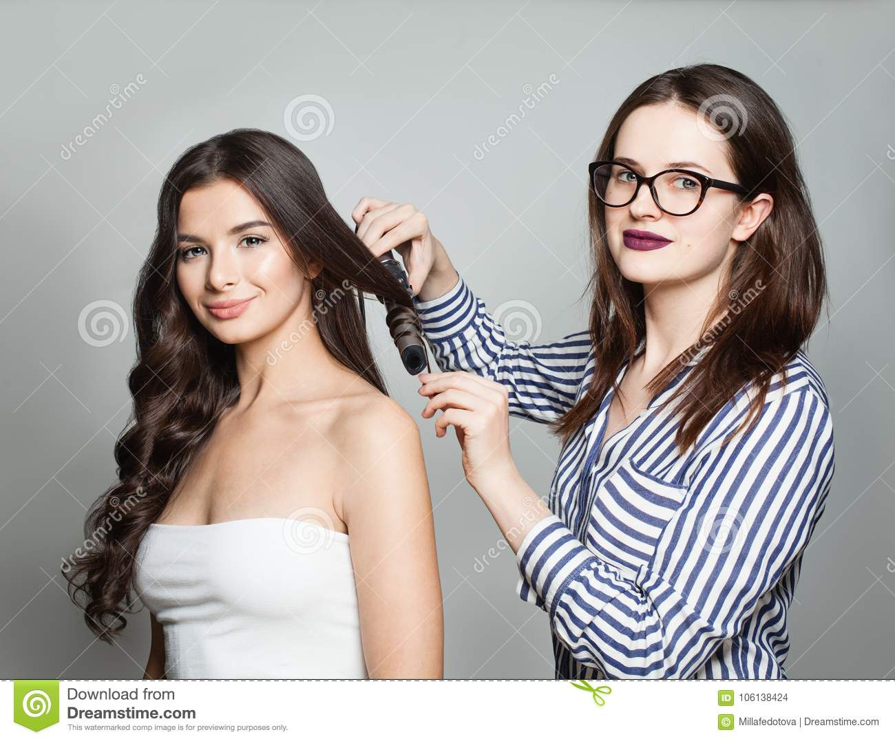 Hairstylist Using Curler For Perfect Curls
