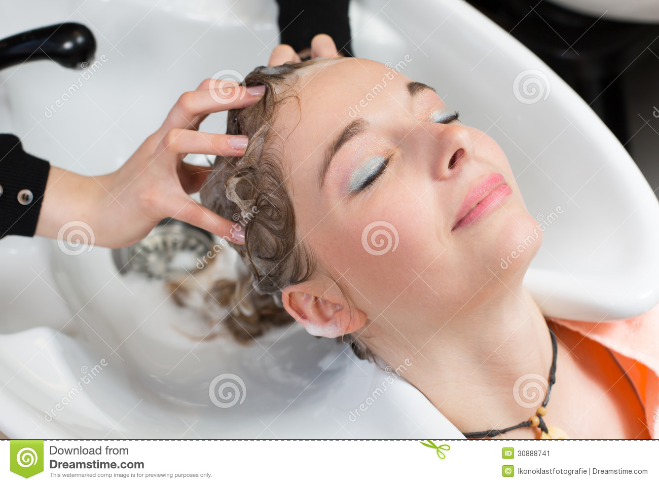 Hairstylist washing customers hair stock image image of for Wash hair salon