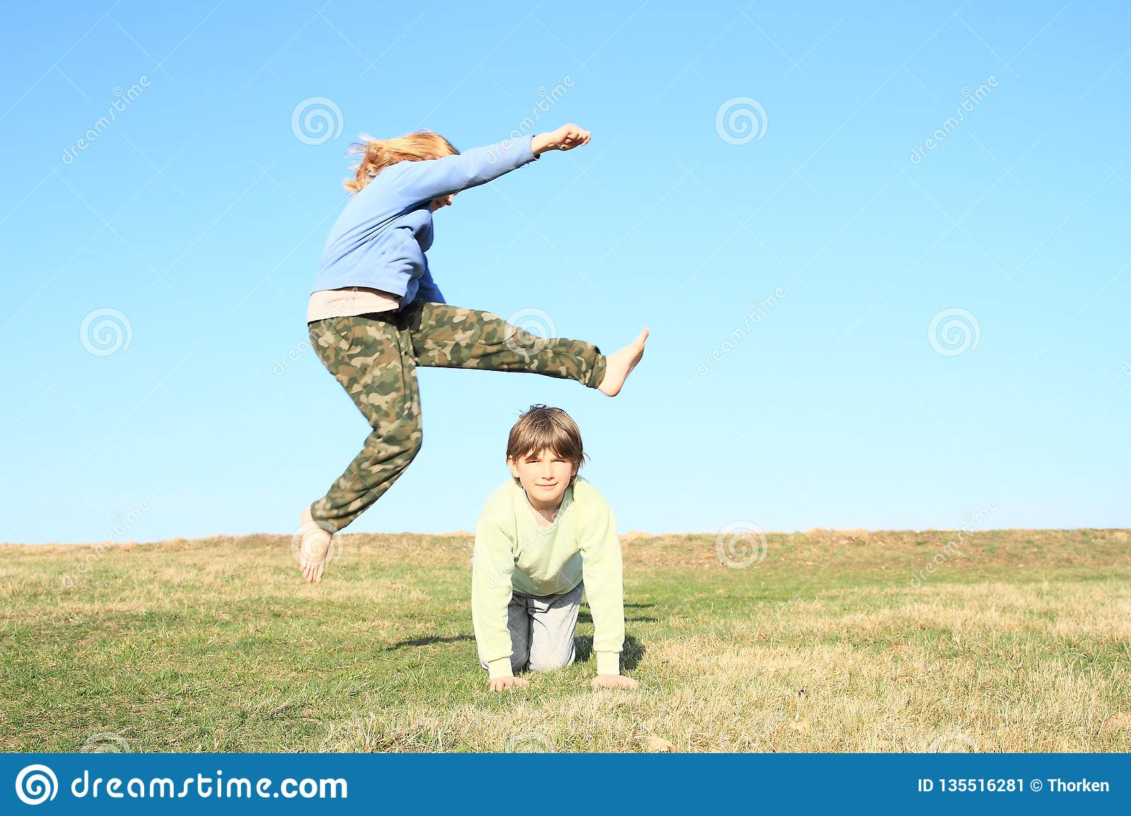 Barefoot Girl Jumping Over Boy Stock Image - Image Of -4848