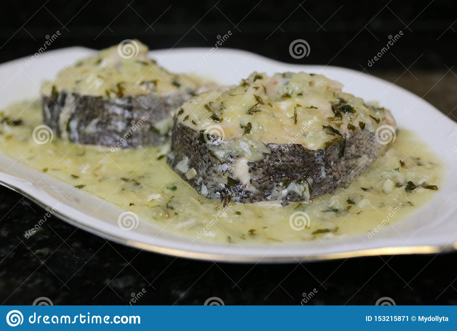 Hake in green sauce a very popular fish dish