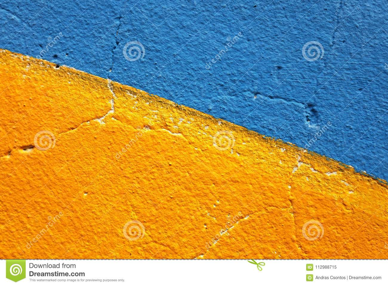 Half of blue and half of yellow painted grunge wall for backgroud