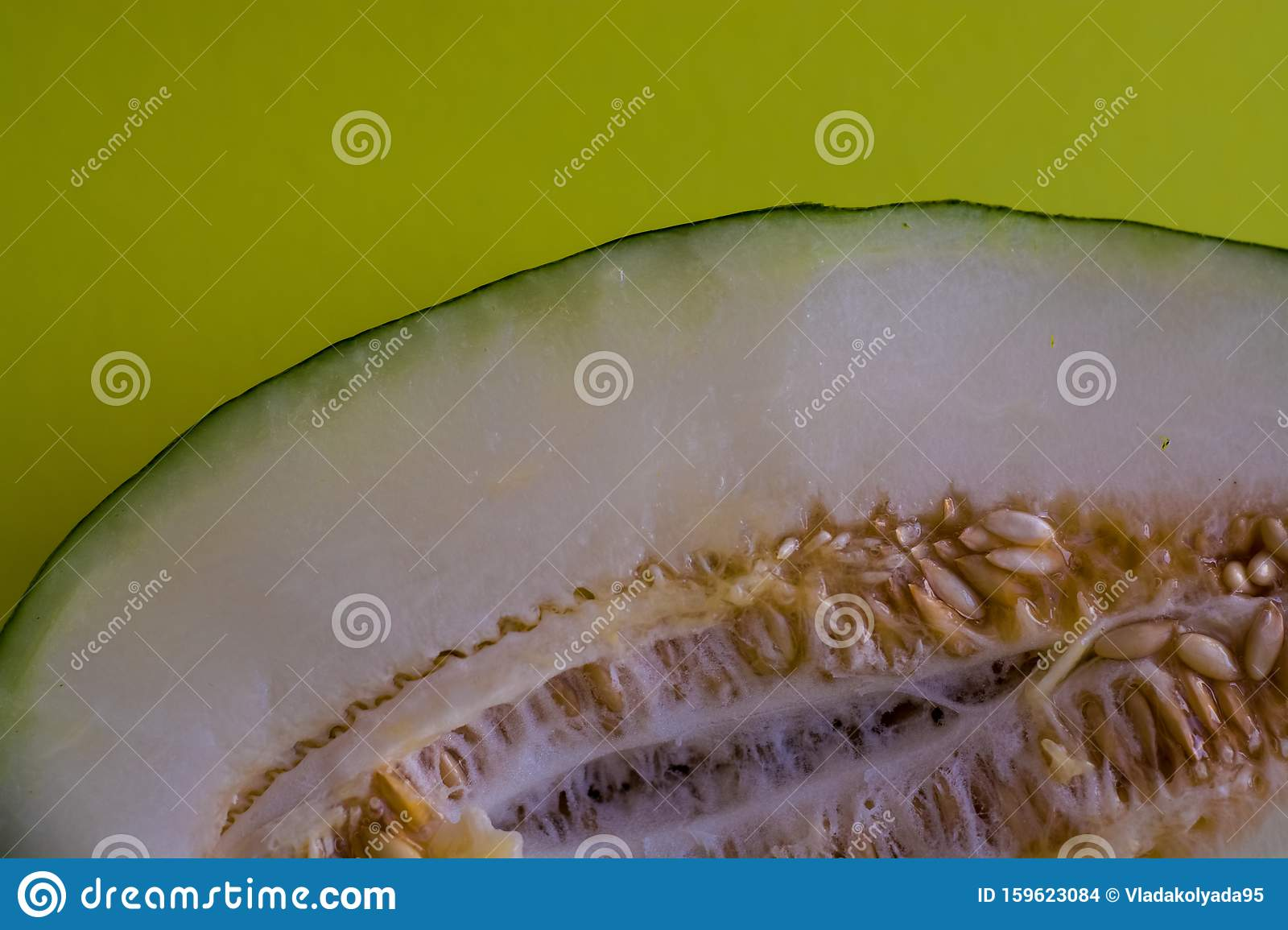 Half Of The Cut Ripe Melon With Seeds On One Ton Green Background Useful Fruit Summer Season Vitamins Stock Photo Image Of Part Cantaloupe 159623084 When in season, juicy cantaloupe is one of our favorite melons. dreamstime com