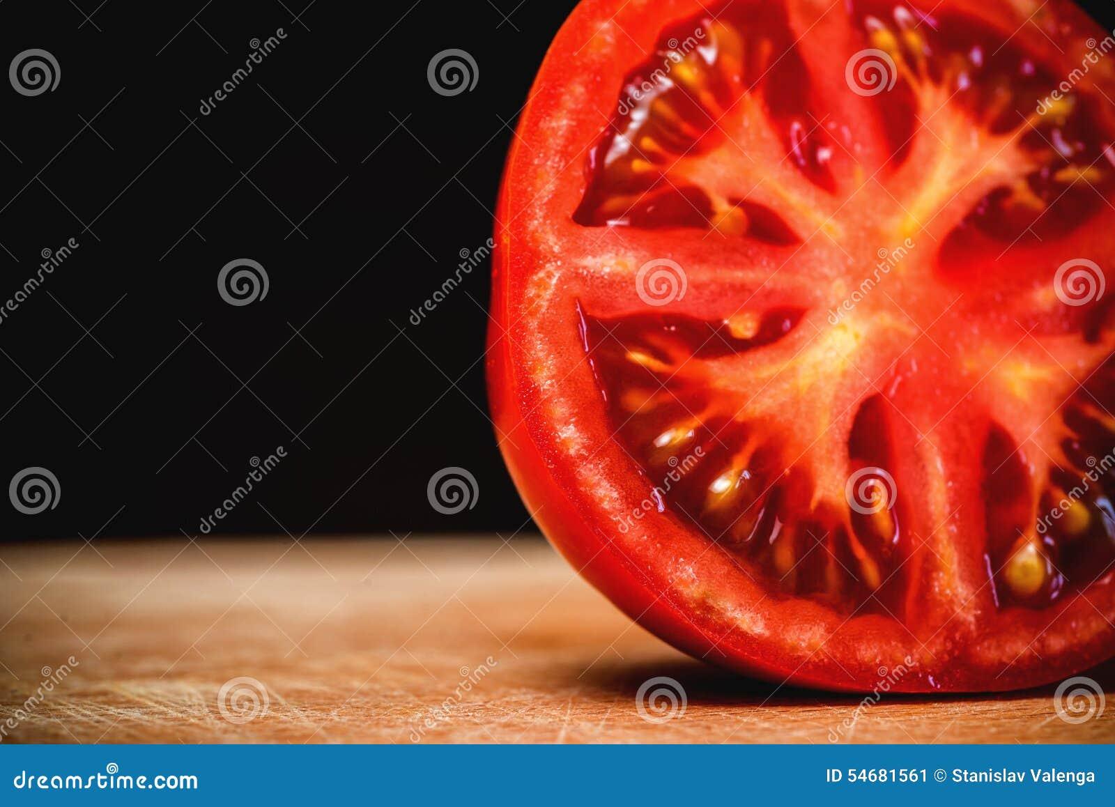 Half Cut Sliced of Fresh Tomato on Wood Table