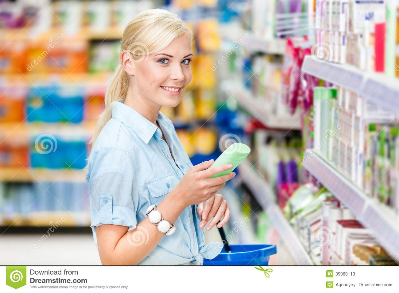 Half length portrait of girl at the shop choosing cosmetics
