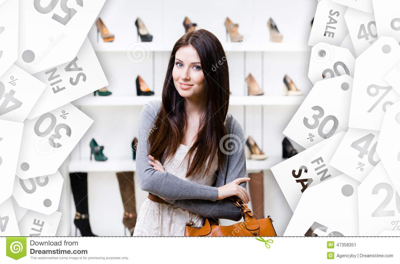 Half-length portrait of lady in shopping center. Seasonal sale