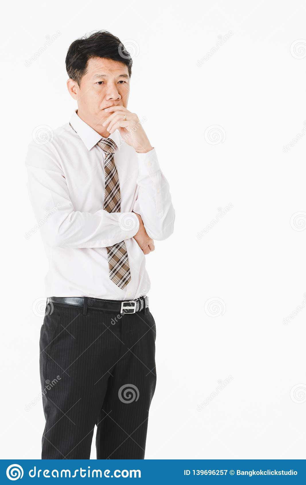 Half-length portrait of middle aged, handsome, Asian, businessman, in white shirt, striped tie.suffer from acute migraine, grimace