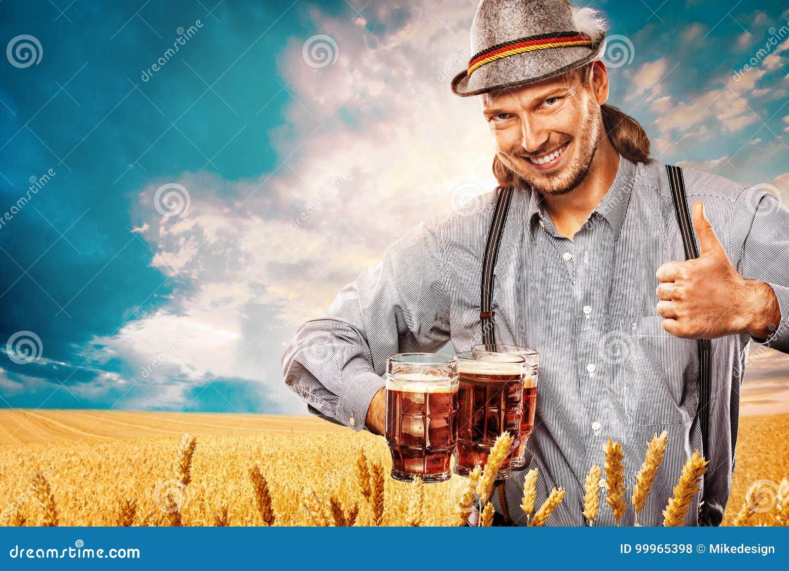 Portrait of Oktoberfest man, wearing a traditional Bavarian clothes, serving big beer mugs.
