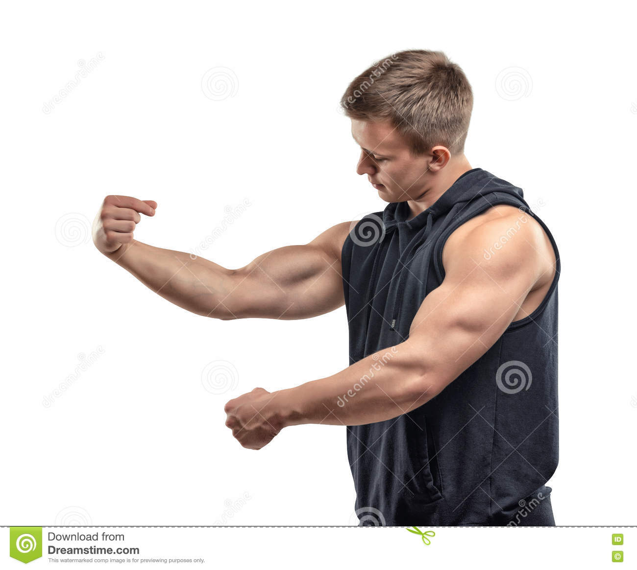 Half Length Of Young Muscular Man Posing And Shows Arm Muscles