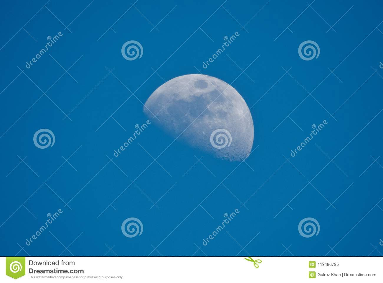 Half moon in day time in beautiful blue sky, Indore-India