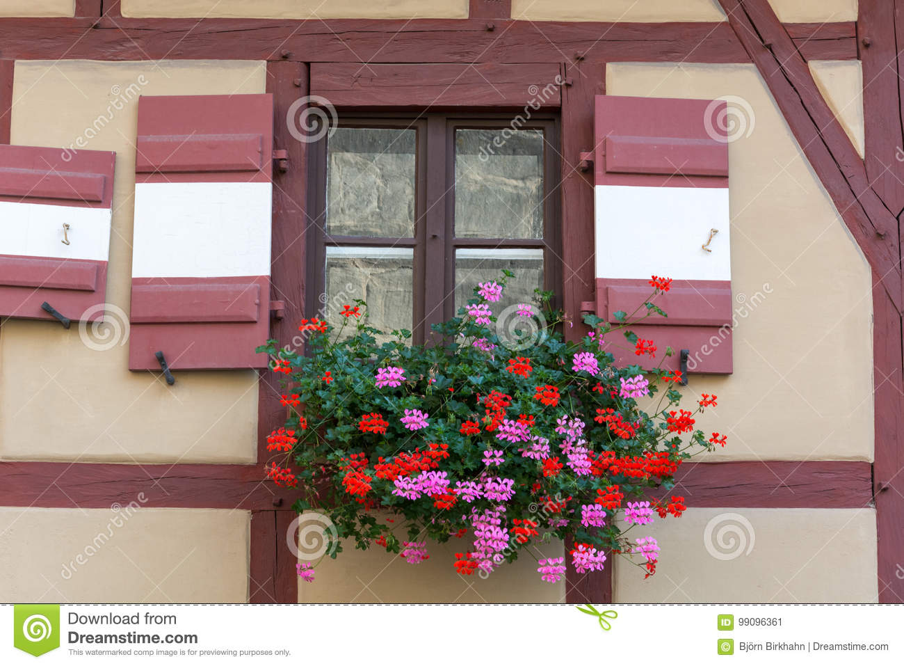 Half Timbered House With Window Shutters And Flowers Stock