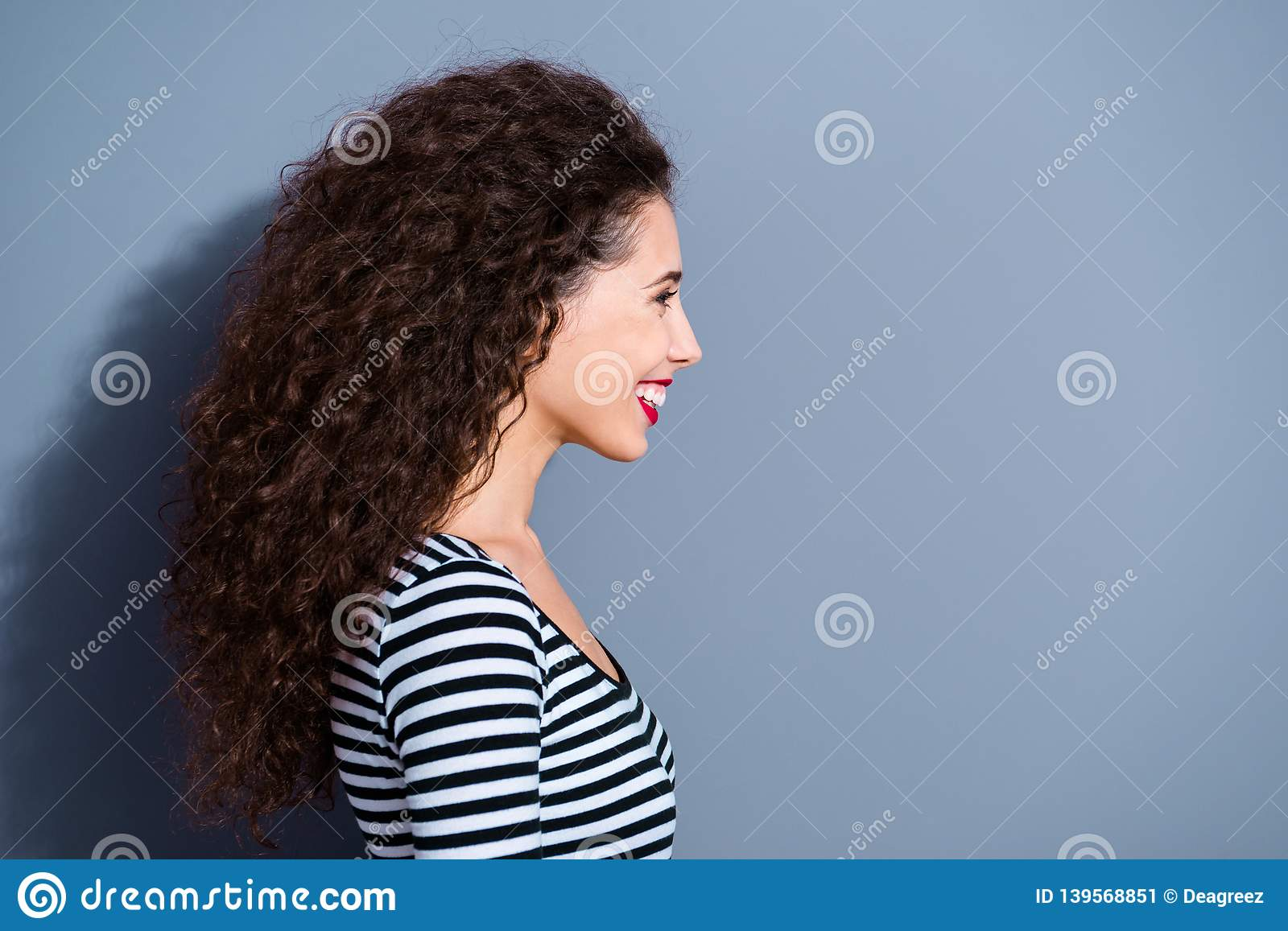 Half-turned close up photo portrait of pretty attractive sweet lovely dreamy adorable charming cute lady looking aside